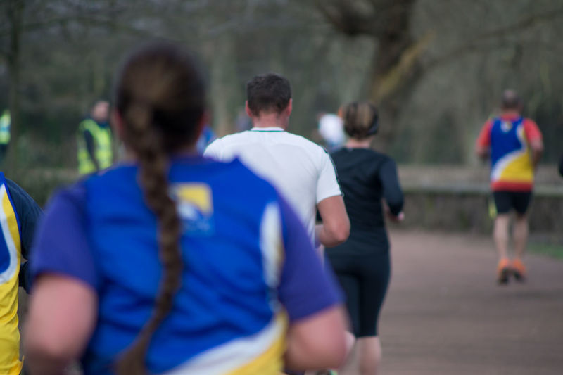 Run Runners Running Athlete Clothing Competition Day Focus On Foreground Group Of People Incidental People Men Outdoors Parkrun People Race Real People Rear View Runner Sport Sports Sports Clothing Sports Photography Team Sport Women