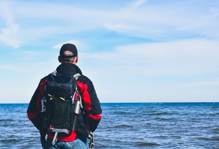 man looking at the sea Nature Beautiful Outdoors View Looking People person One Person Copy Space Blue Sky Traveler Lifestyles Tourist Backpack Water Sea Wave Standing Body Part Water Sea Sport Adventure Healthy Lifestyle Men Sky Horizon Over Water Hiker Hiking Hiking Pole