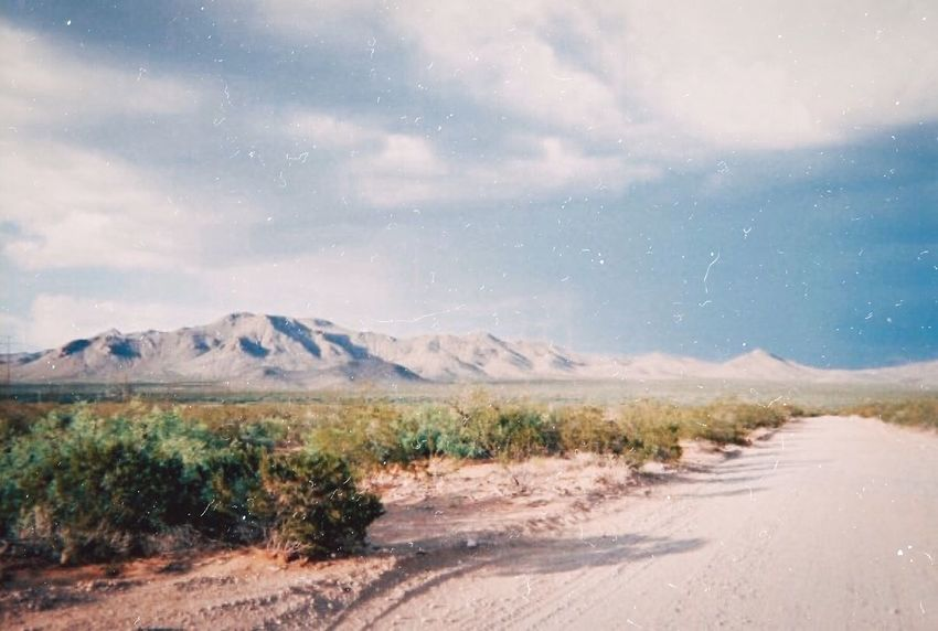 Desert Road Mountain Road Landscape Nature Scenics Sky No People Day Outdoors Beauty In Nature Tranquility Tranquil Scene Cloud - Sky Mountain Range