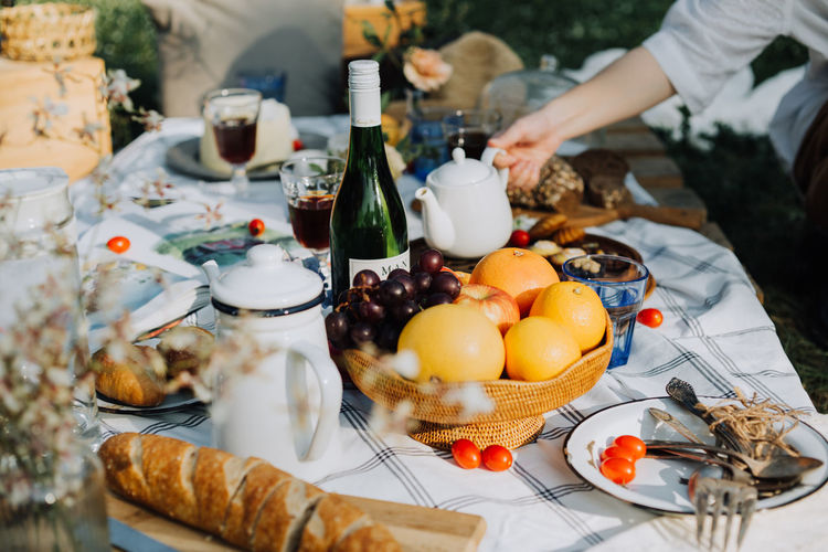 High angle view of food and drink on table in yard