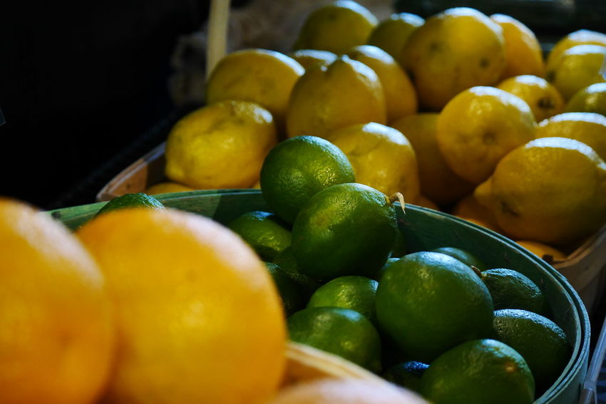 Beautiful healthy food. Lemons and limes. Abundance Bowl Bushel Baskets Choice Citrus Fruit Close-up Food Freshness Fruit Healthy Eating Juicy Large Group Of Objects Lemon Lemons And Limes Lime Multi Colored Organic Raw Food Ready-to-eat Ripe Selective Focus Still Life Variation Yellow
