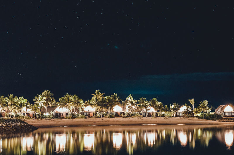 Bures under the stars Beauty In Nature Bure Fiji Illuminated Lagoon Nature Night Nightphotography No People Outdoors Palm Trees Reflection Scenics Sky Tree Water Waterfront