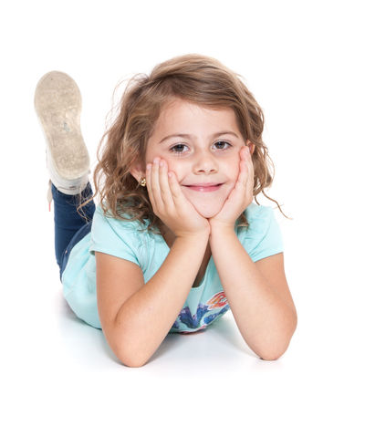 Young girl. All on white background. Child Childhood Curly Hair Full Length Girl Girlhood Happiness Happy Girl  Isolated On White Isolated White Background Kid Lying Down One Person Positive Attitude Smiling Studio Shot White Background Young Girl Youth