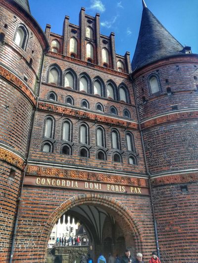 Architecture Building Exterior Built Structure Travel Destinations Low Angle View Arch History Window Day Outdoors Politics And Government Clock Tower City Clock No People Sky Clock Face Holstentor Holstentor Lübeck Holstentorplatz Lübeck, Germany