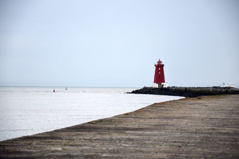 Poolbeg, the red lighthouse in Dublin Dublin Dublin, Ireland Poolbeg Architecture Beach Building Building Exterior Built Structure Day Direction Horizon Horizon Over Water Land Lighthouse Outdoors Poolbeg Lighthouse Protection Safety Sea Security Sky Tower Water