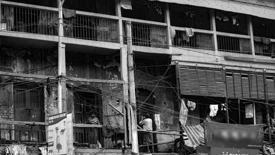 Architecture Barabazaar Black And White Building Exterior Built Structure Calcuttadiaries Calcuttastreets EyeEm EyeEm Best Shots Kolkatacity Line And Shape Men Old Building Charms Old Building Exterior Old Buildings Not Forgotten Old Structures Real People Streetphotography Structures & Lines Structures And Architecture Tonality Window