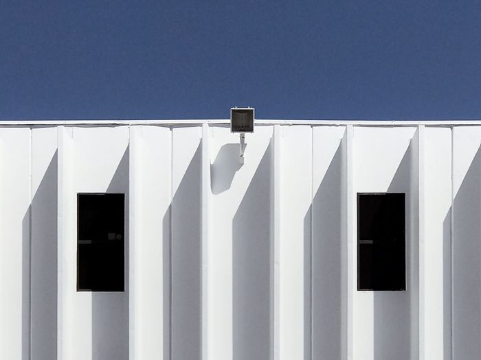 Unicorn. White Color Architecture Built Structure Day Whitewashed No People Blue Building Exterior Sunlight Clear Sky Sky Lines Textured  Pattern Wall Shadows Shadow Sunlight Wall - Building Feature Public Building Building Clear Sky Sunny Copy Space