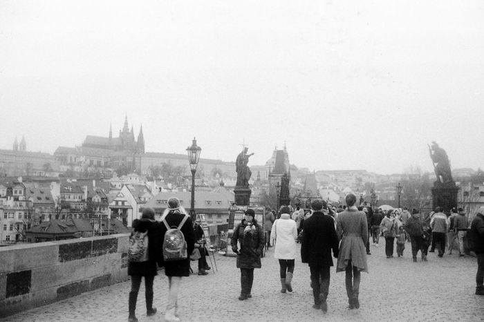 Prague Charles'bridge people walking romantic view black and white argentique Prague Charles Bridge 35mm Film Nofilter Filmphotography Blackandwhite People Walking By Old Town Romantic Scenery