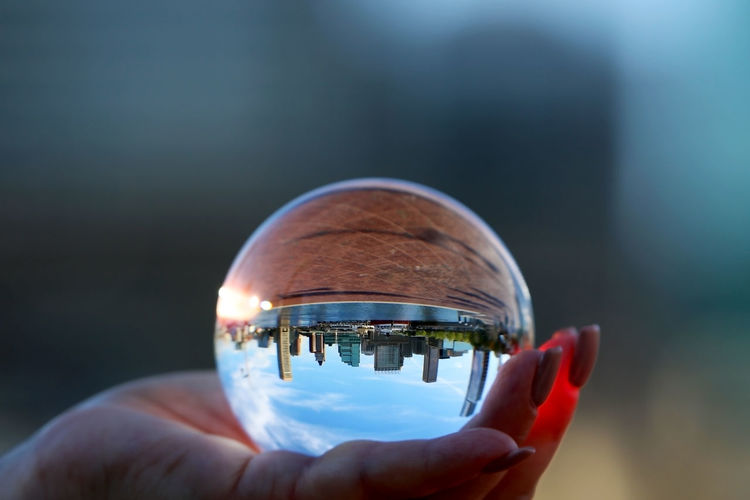 Cropped image of woman holding crystal ball