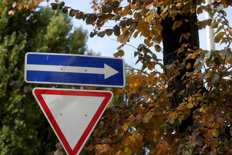 Low angle view of road sign against trees