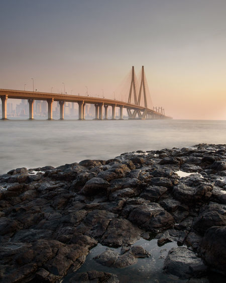 Sea starts where lands end Architecture Engineering Sealink Bridge - Man Made Structure Long Exposure Arabian Sea India Travel Nature Travel Destinations Travel Solo Wanderlust Wallpaper City Cityscape Urban Skyline Water Low Tide Sea Sunset Horizon Beach Skyscraper Water Surface