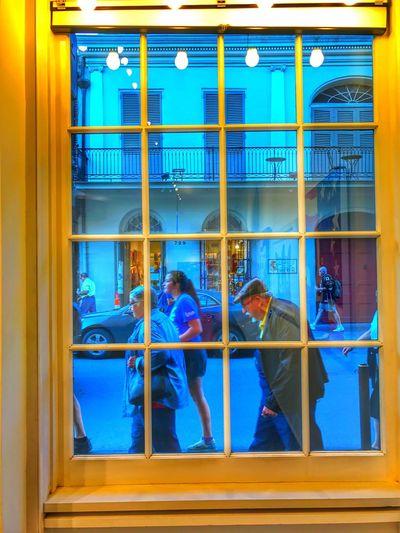People seen through window