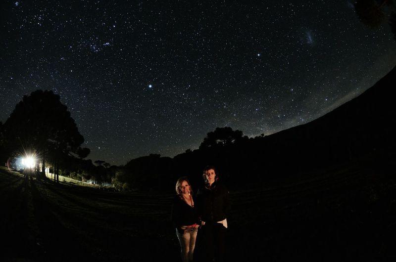 Portrait of women standing on field against star field
