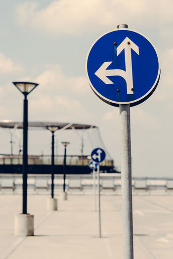 Is it right ... Blue Directional Sign Guidance Information Information Sign Is It Right No Cars  No People Parking Parking Lot Right Or Wrong Road Sign Sign Sky Straight Forward Street Light The Way Forward Mein Automoment Automobile No Car