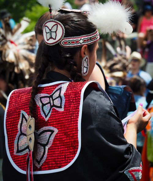 Powwow Dancer Back View Of Girl Beadwork Butterfly Motifs Celebration Event Focus On Foreground Headdress Indigenous Culture Indigenous Woman Native American One Person Outdoors Powwow Real People Regalia Standing Symbolic  Traditional Clothing Waist Up The Portraitist - 2018 EyeEm Awards