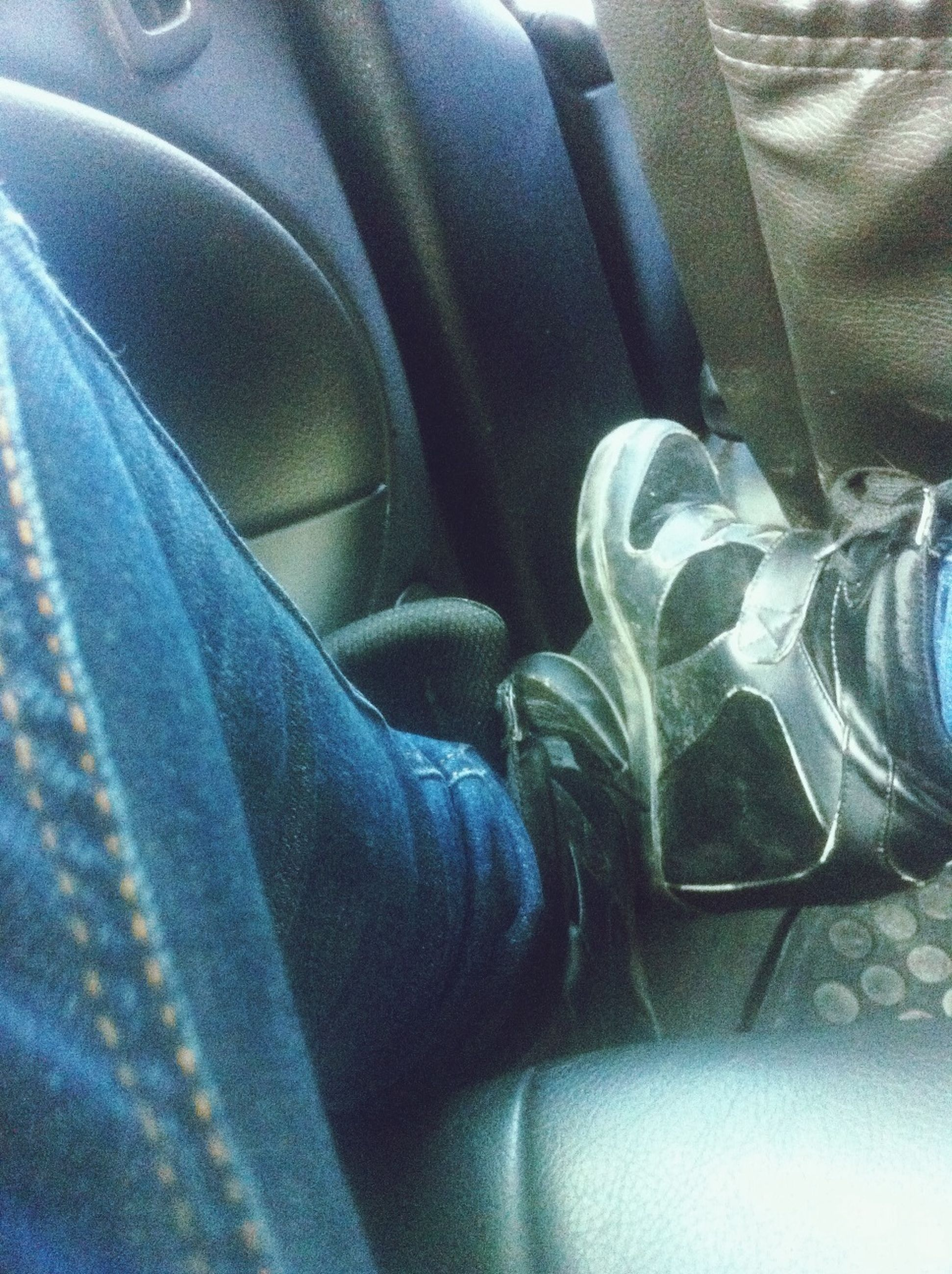 indoors, vehicle interior, person, transportation, low section, land vehicle, vehicle seat, mode of transport, close-up, car, part of, textile, jeans, relaxation, car interior, sitting, shoe