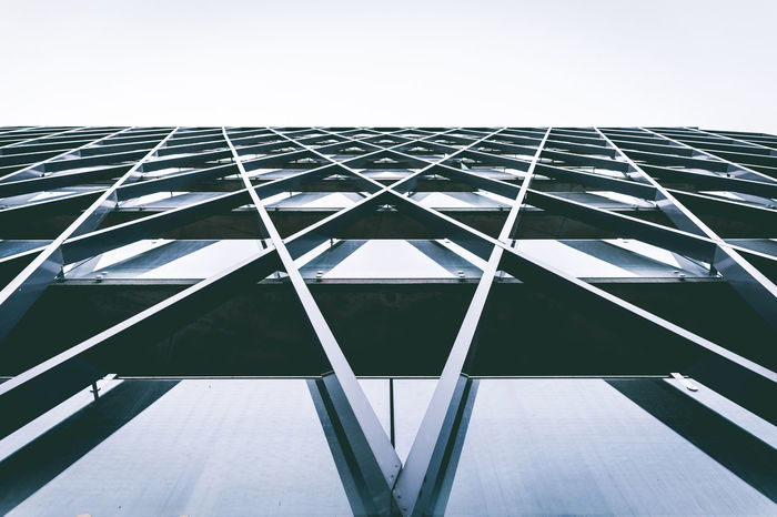 Architectural Feature Architecture Building Built Structure City Design Film Geometric Shape Lookup Modern No People Office Building Outdoors Reflections Sky Tall Tall - High Tower Vntage VSCO Windows