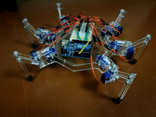 Building the second version of my robotic spider. No People Indoors  Close-up Day CRAFTHOLIC Noperson DIY No Filter Indoors  Robot Spider Arduino Arduino Uno Plexiglass Servo Breadboard Cables Programming Robotic Motion Just Edit Little Bit