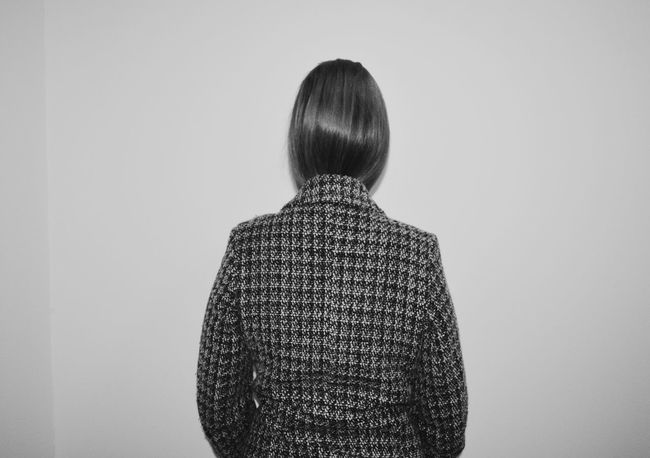 Wearing Woman Women Only Coat Minimal Blackandwhite Blackandwhite Photography Blackandwhite Portrait Portrait Monochrome monochrome photography Rear View Hair Bun Society Beauty Pattern Textured  Posing White Background Capture Tomorrow
