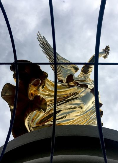 Low angle view of sculpture against sky