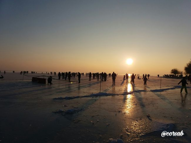 Magyarország Vonyarcvashegy Hungary Balaton Frozen Lake ❄️frozen❄️ Samsungphotography EyeEm Gallery Silhouette Sunset Winter Photography Outdoors Real People Large Group Of People Beach Sunset Silhouette Silhuoette EyeEm Best Shots