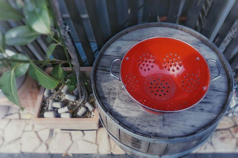 High Angle View Of Red Saucepan On Barrel