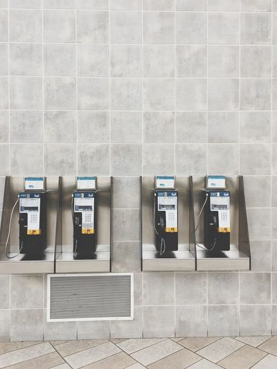 Pay phones mounted on wall