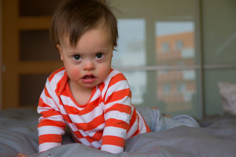 Babyboy Bed Bedroom Childhood Close-up Cute Day Down Syndrome Downsyndrome Home Interior Illness Indoors  Lifestyles Looking At Camera Mental Health  One Person People Portrait Real People Striped