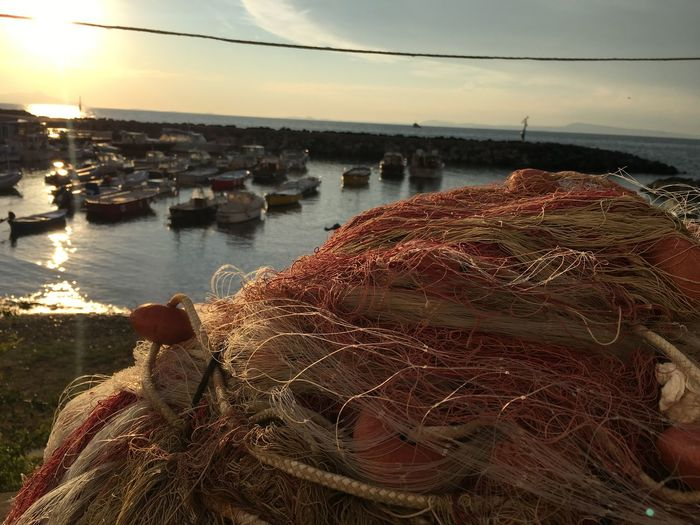 Fishman. Beach Beauty In Nature Close-up Day Fishing Equipment Fishing Net Fishing Tackle Harbor Horizon Over Water Men Nature Nautical Vessel One Person Outdoors People Port Real People Sea Sky Sunset Water