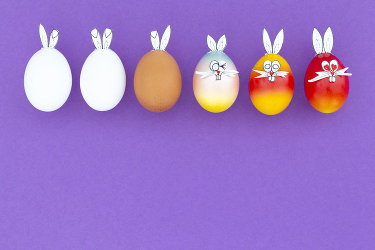 Close-up of easter eggs against blue background