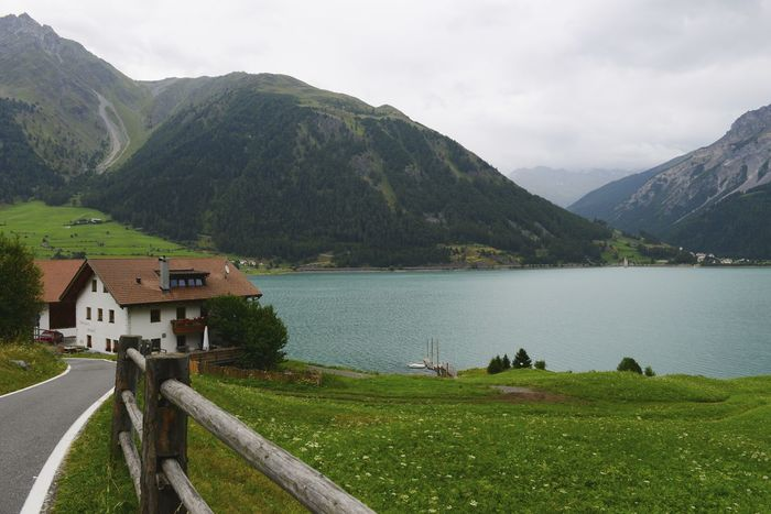 Cycling through the Reschenpass on the way to Rome Alps Italy Reschensee Alps Day Italy Lago Di Resia (Reschensee) Lake Lakeside Mountain Mountain Range Nature Outdoors Reschen Reschenpass Scenics Tranquil Scene Tranquility Water