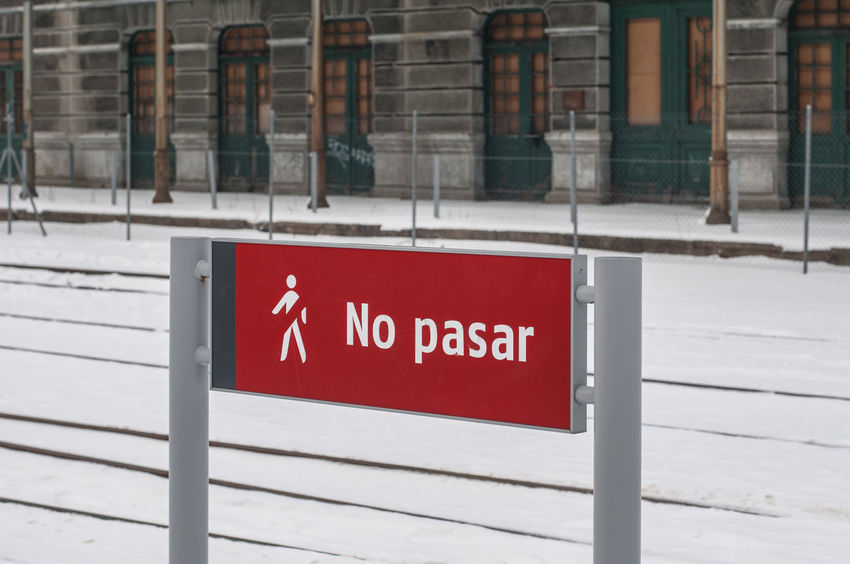 """No pasar"". Abandoned station in Canfranc in Winter ©alexander h. schulz Canfranc Doors Pyrenees SPAIN Sign Station Winter Abandoned Architecture Building Exterior Built Structure Close-up Closed Cold Temperature Day No Pasar No People Outdoors Red Snow Text Tracks Tracks In Snow Train Station Window"