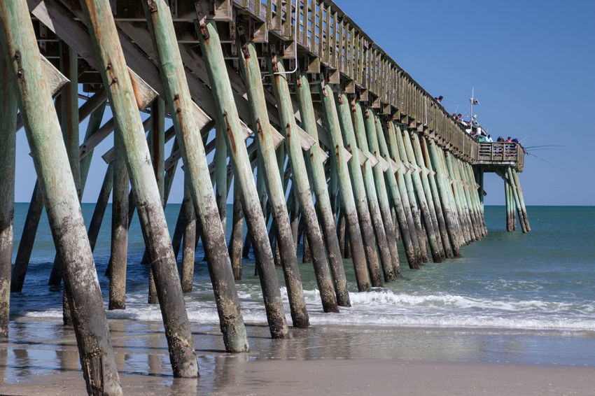 Pier at Myrtle Beach State Park Aquatic Sport Architectural Column Architecture Beach Beauty In Nature Built Structure Clear Sky Day In A Row Land Nature No People Outdoors Pier Scenics - Nature Sea Sky Water Wave Wood - Material Wooden Post