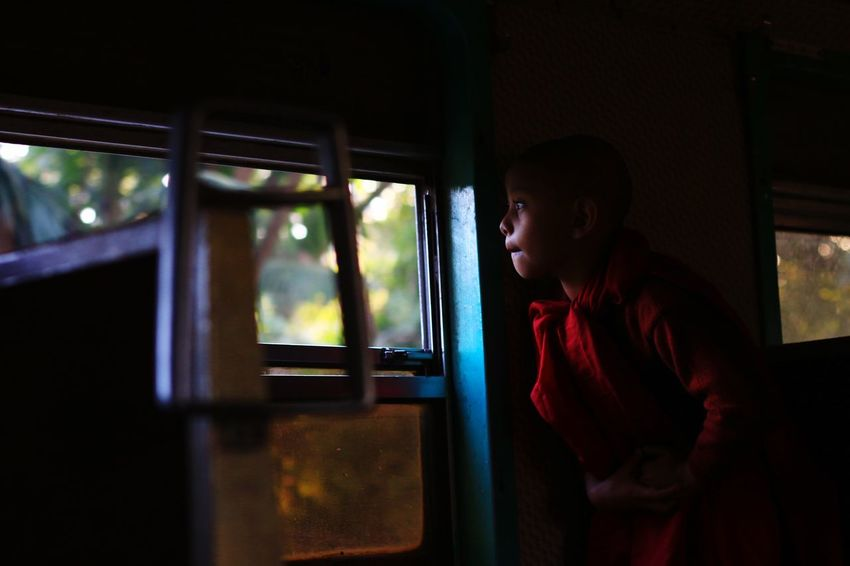 A little monk on the train Creative Light And Shadow Myanmar Street Photography