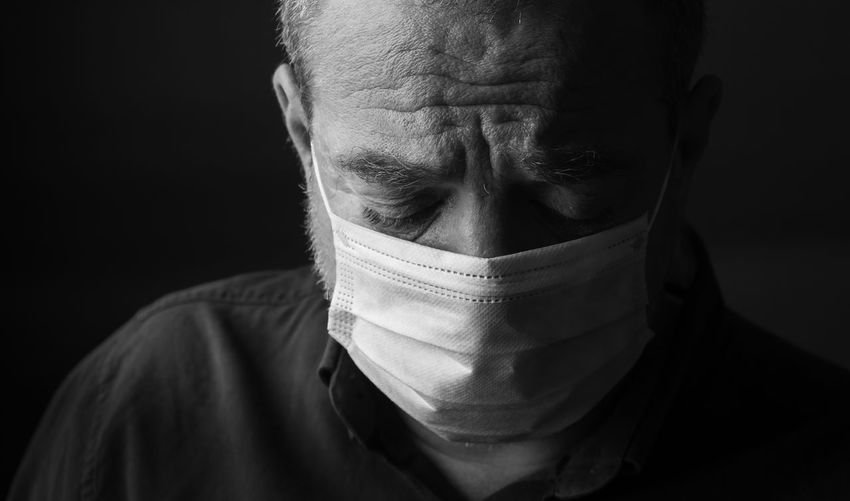 Unhappy male doctor in a medical mask