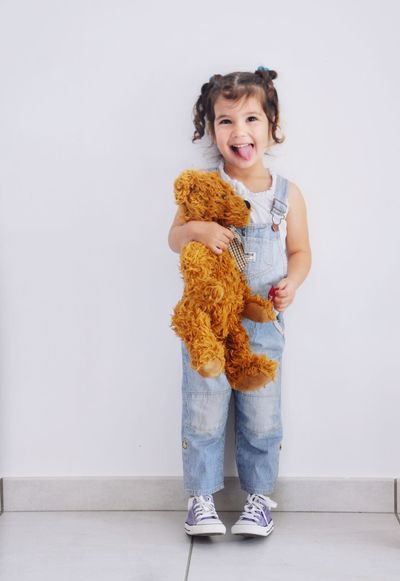 Kidsphotography Expression Smile Happy Goofing Around Teddybear Ready For School Piggytails Overalls Dungarees Kids Fashion  Kids Of EyeEm Doudou ❤ Microfashion Innocence Kids Face Proud Mommy Loulou Everyday Emotion