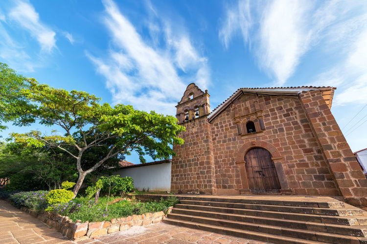View of the chapel of Jesus in the historic colonial town of Barichara, Colombia Architecture Barichara Building Cathedral Church Colombia Colonial Colorful Exterior Façade Front Historic History Latin Old Sandstone Santander Southamerica Spanish Street Tourism Town Travel Wall White