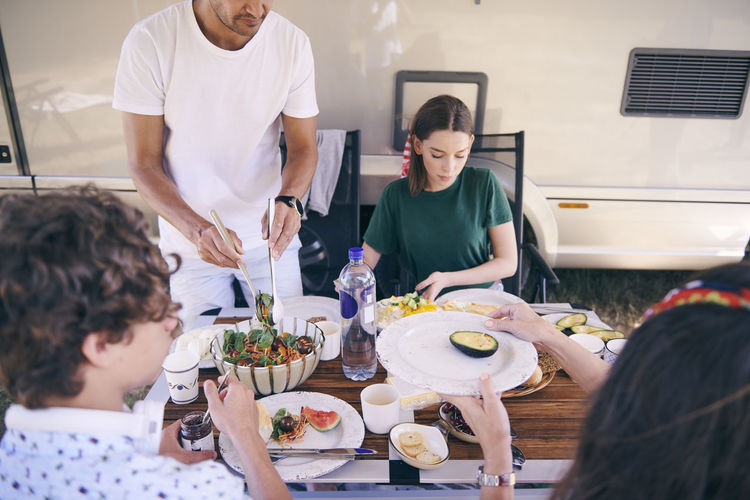 Group of people having food at table