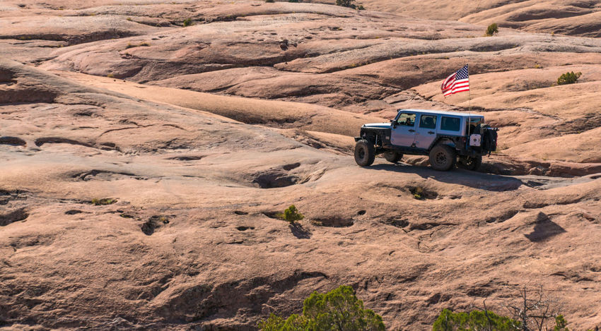 Four Wheeling Jeep in Moab American Flag Moab, Utah Rock Adventure Climbing Four Wheeling Jeep Vehicle