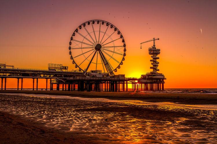 Sunset Water Sky Sea Orange Color Built Structure Amusement Park Ride Architecture Ferris Wheel Amusement Park Beach Pier Scenics - Nature No People Outdoors