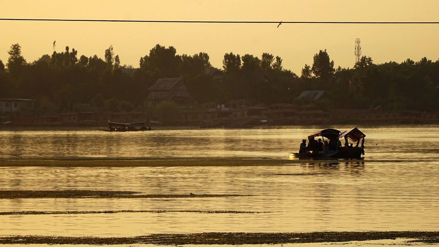 Kashmir Valley Boats Day EyeEmNewHere Fishing Focus On Foreground Garden Grass Growth Himalayas Lake Leaves Mountains Nature No People Outdoors Rakeshtiwari Real People River Shikara Ski Slope Snowy Peaks Sunset Sunsets Travel Trees