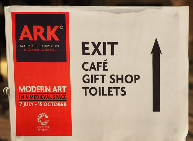 Inside Chester cathedral - Chester, UK Red Day Outdoors Text Communication Close-up Chester Cathedral No People Exit Sign Western Script Up Arrow Way Out Sign Emergency Sign Cafe Sign Gift Shop Sign ARK Exhibition Modern Art Exhibition Toilets Sign