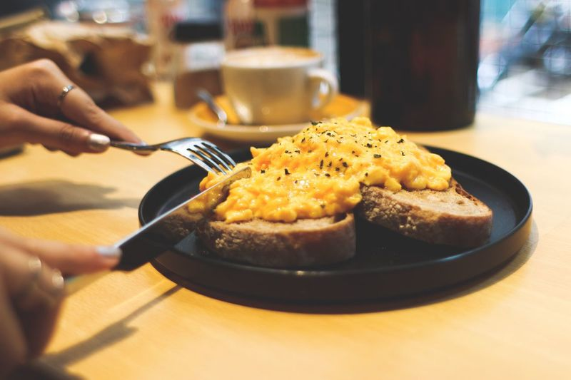 Food And Drink Food Indoors  Ready-to-eat Close-up Plate Brunch Time Scrambled Eggs Breakfast Meal Eating Out Cutting On The Table Cafe Close Up Photography Close Up Food Always Be Cozy Bread