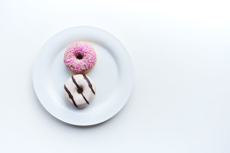 Directly above shot of cake in plate against white background