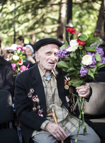 World War II veterans The Photojournalist - 2018 EyeEm Awards Adult Business Clothing Day Flower Flower Arrangement Flowering Plant Focus On Foreground Glass Group Of People Incidental People Leisure Activity Lifestyles Males  Mature Men Men Outdoors People Plant Real People Senior Adult Senior Men Suit Well-dressed