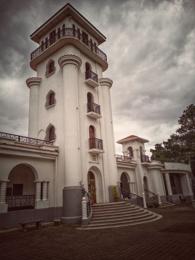 A tower of the old airport at San José, Costa Rica. Now the whole building is the Museum of Costa Rican Art ✈️🖌️ Museum Tower Old Airport Historical Building Costa Rica Art Architecture Raw Huawei Photography Tree Place Of Worship City Spirituality Religion Façade History Architecture Building Exterior Communications Tower Tall - High Art Museum Aged Architectural Column Historic