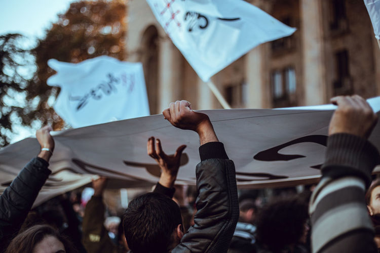 Protesters on street with banners