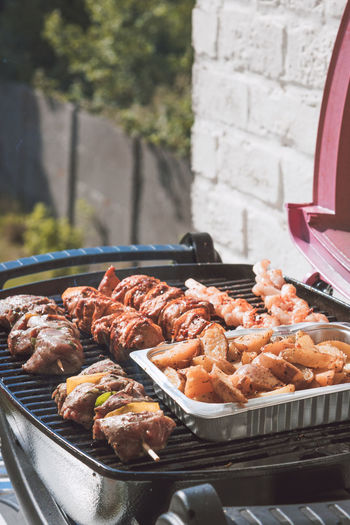 BBQ grilling lams meat, pork meat, prawns and potatoes Barbecue Barbecue Grill Close-up Day Electrical Barbecue Food Food And Drink Freshness Grilled Healthy Eating Lams Meat Meat No People Outdoors Pork Meat Potatoes Prawns Ready-to-eat Seafood Skewered Food Summer