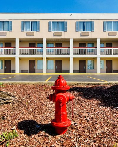 fire red EyeEm Selects Building Exterior Protection Safety Built Structure Security Architecture Fire Hydrant Red Day Occupation Boundary Working Barrier Fence Accidents And Disasters Outdoors Building