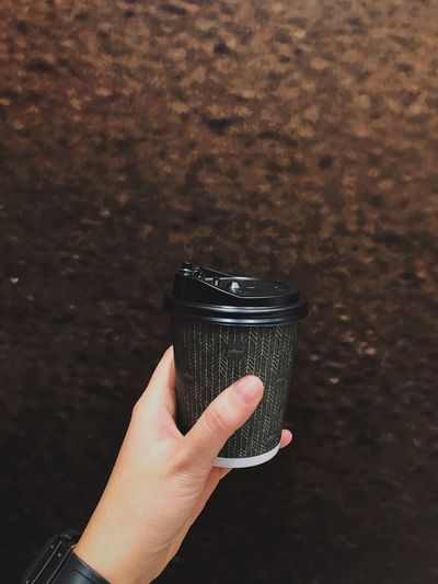 Close-up of person hand holding drink